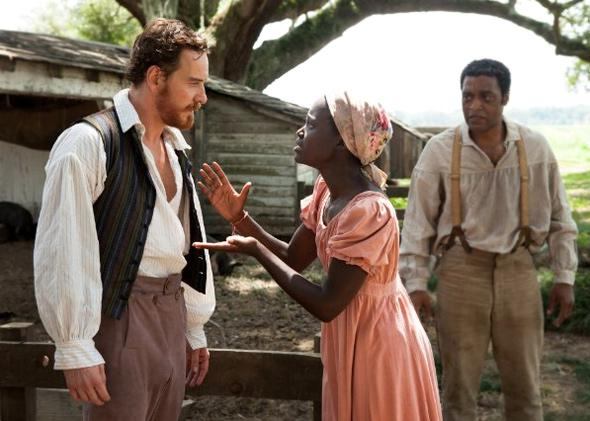 Chiwetel Ejiofor, Michael Fassbender and Lupita Nyong'o in 12 Years a Slave (2013).