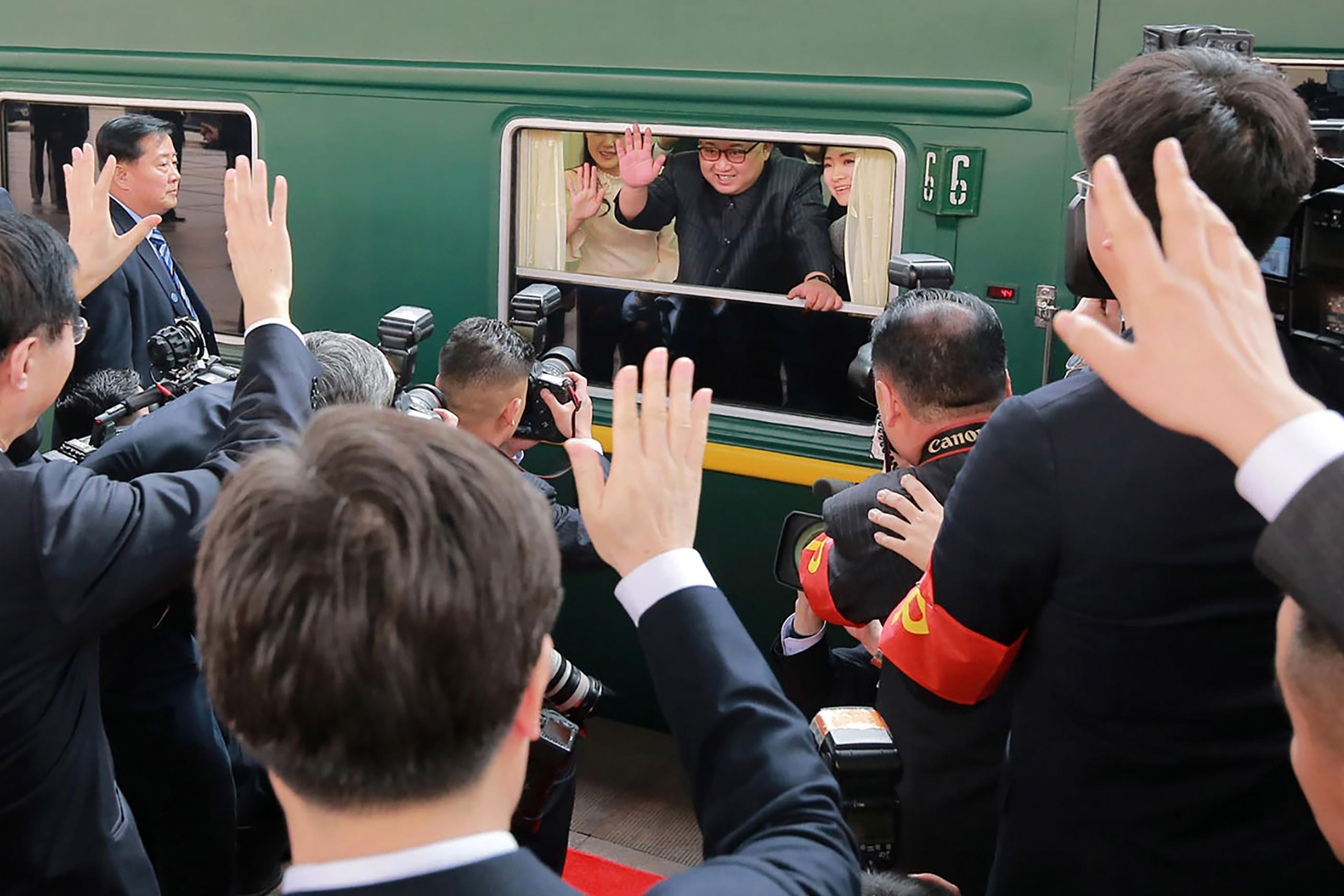 This picture from North Korea's official Korean Central News Agency (KCNA) taken on March 27, 2018 and released on March 28, 2018 shows North Korean leader Kim Jong Un (C) waving from his train as it prepares to depart from Beijing railway station.         North Korean leader Kim Jong Un was treated to a lavish welcome by Chinese President Xi Jinping during a secretive trip to Beijing as both sides seek to repair frayed ties ahead of landmark summits with Seoul and Washington.  / AFP PHOTO / KCNA VIA KNS / - / South Korea OUT / REPUBLIC OF KOREA OUT   ---EDITORS NOTE--- RESTRICTED TO EDITORIAL USE - MANDATORY CREDIT 'AFP PHOTO/KCNA VIA KNS' - NO MARKETING NO ADVERTISING CAMPAIGNS - DISTRIBUTED AS A SERVICE TO CLIENTS         THIS PICTURE WAS MADE AVAILABLE BY A THIRD PARTY. AFP CAN NOT INDEPENDENTLY VERIFY THE AUTHENTICITY, LOCATION, DATE AND CONTENT OF THIS IMAGE. THIS PHOTO IS DISTRIBUTED EXACTLY AS RECEIVED BY AFP.  /         (Photo credit should read -/AFP/Getty Images)