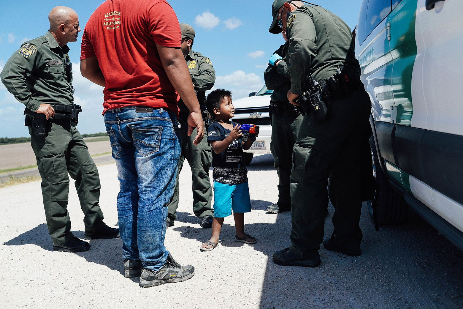 A boy and father from Honduras are taken into custody by U.S. Border Patrol agents near the U.S.–Mexico border on Tuesday.