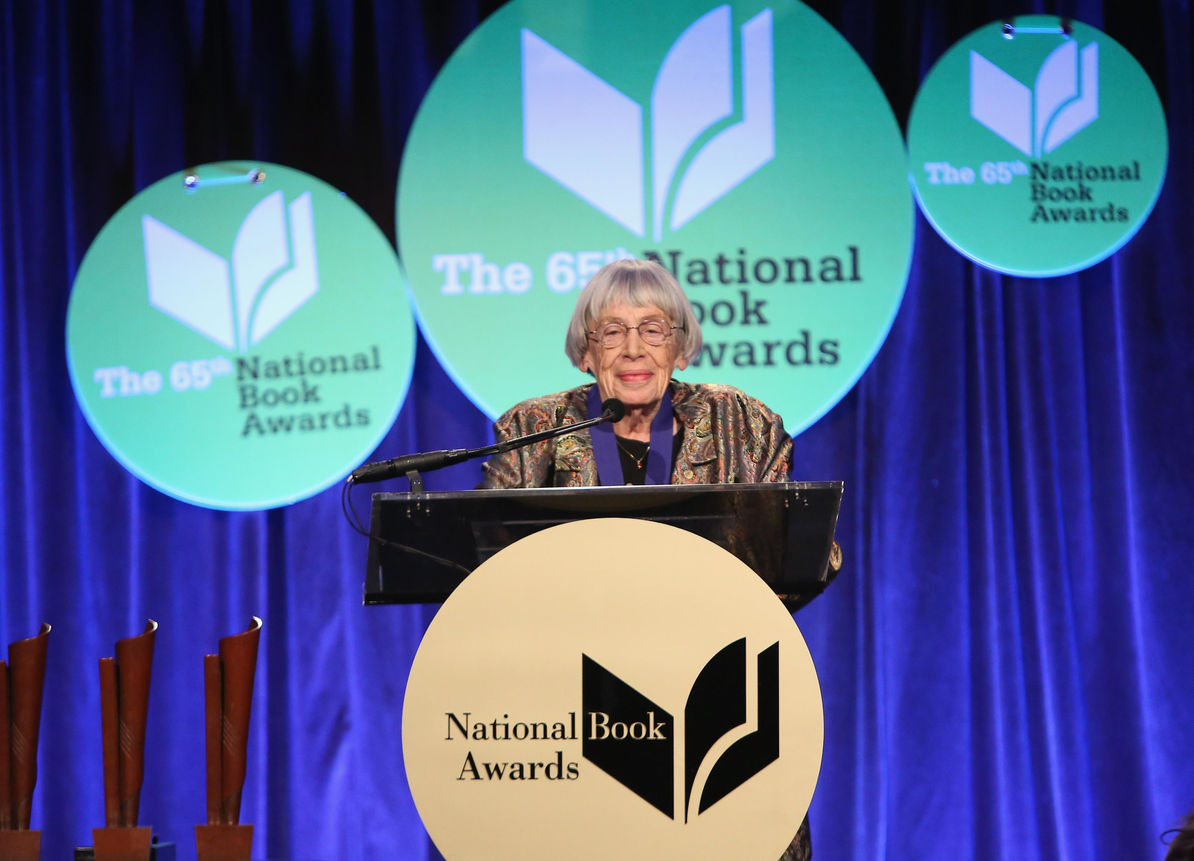 Ursula K. Le Guin stands at a podium.