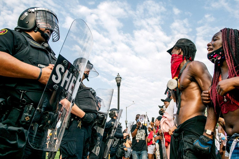 Police in riot gear face off against Black Lives Matter protesters