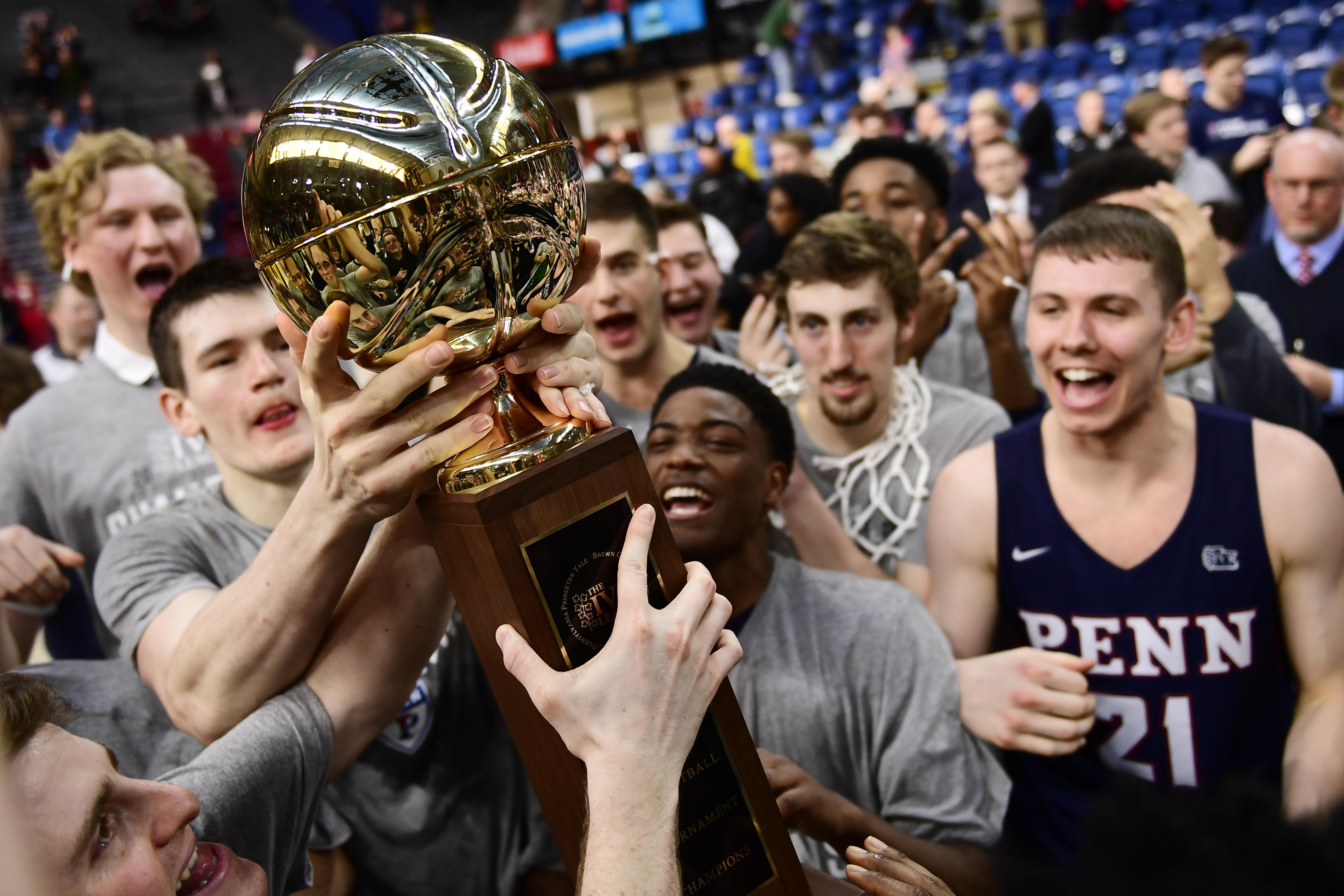 PHILADELPHIA, PA - MARCH 11: The Pennsylvania Quakers men's basketball team hold up the championship trophy after winning the Men's Ivy League Championship Tournament at The Palestra on March 11, 2018 in Philadelphia, Pennsylvania. Penn defeated Harvard 68-65. (Photo by Corey Perrine/Getty Images)