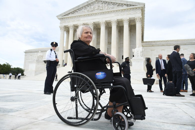 Aimee Stephens in front of the Supreme Court in her wheelchair.