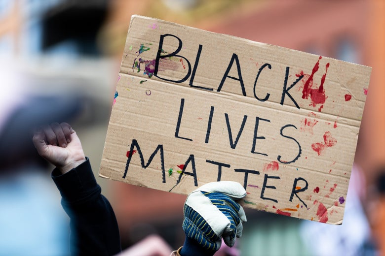 """Protesters holding a """"Black Lives Matter"""" sign during a march on the final day of the trial."""