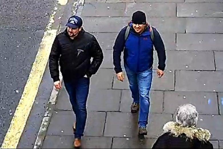 Alexander Mishkin and Anatoliy Chepiga walking on a sidewalk.