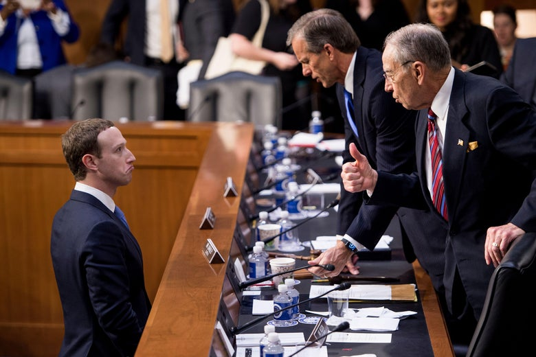Facebook CEO Mark Zuckerberg (L) speaks with Senator John Thune (C), R-SD, and Senator Chuck Grassley (R), R-IA following a joint hearing of the Senate Commerce, Science and Transportation Committee and Senate Judiciary Committee on Capitol Hill April 10, 2018 in Washington, DC.         Facebook chief Mark Zuckerberg took personal responsibility Tuesday for the leak of data on tens of millions of its users, while warning of an 'arms race' against Russian disinformation during a high stakes face-to-face with US lawmakers. / AFP PHOTO / Brendan Smialowski        (Photo credit should read BRENDAN SMIALOWSKI/AFP/Getty Images)
