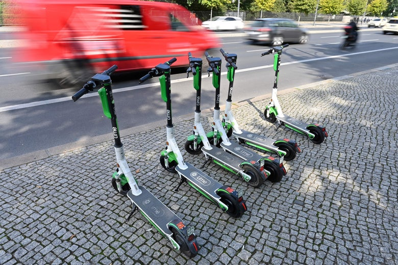A row of e-scooters on a Berlin sidewalk on Sept. 13, 2019.
