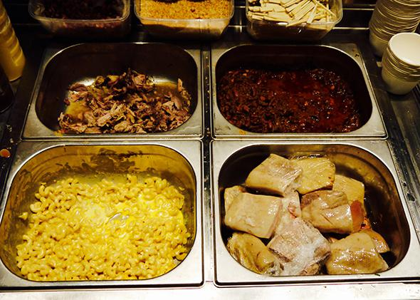 The pulled pork, baked beans, mac and cheese, and biscuit station at Truck De Luxe.