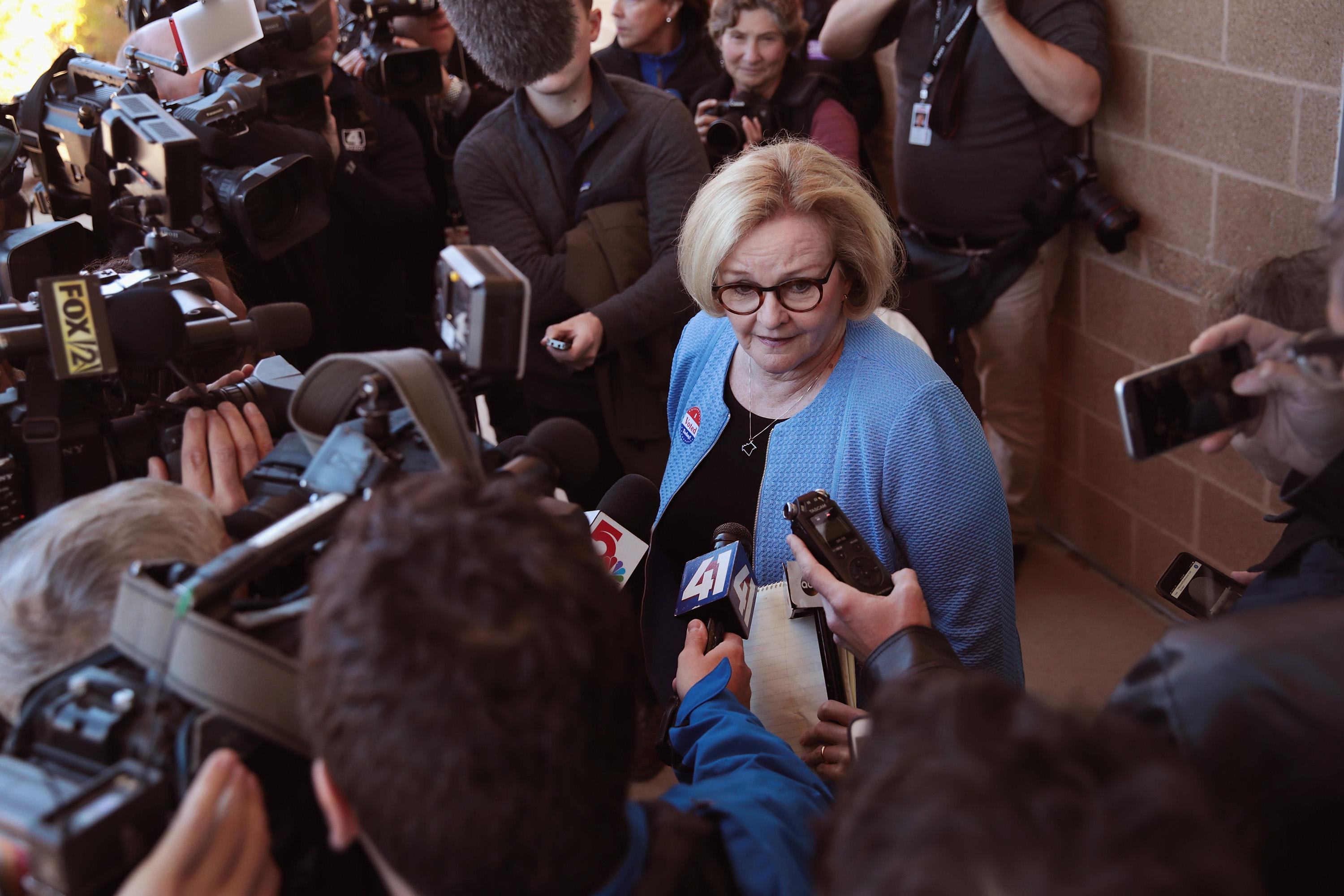 Senator Claire McCaskill (D-MO) speaks with reporters as she leaves the polling station after voting on November 6, 2018 in Kirkwood, Missouri.