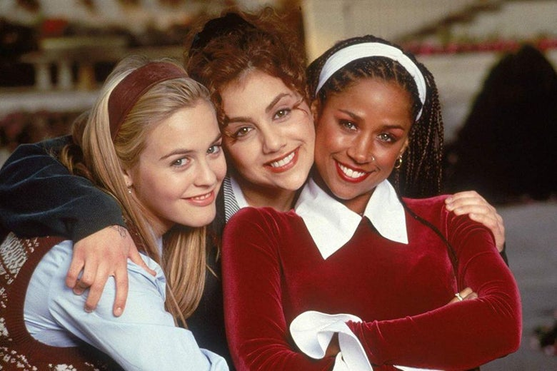 Alicia Silverstone, Stacey Dash, and Brittany Murphy embrace, smile and look at the camera.