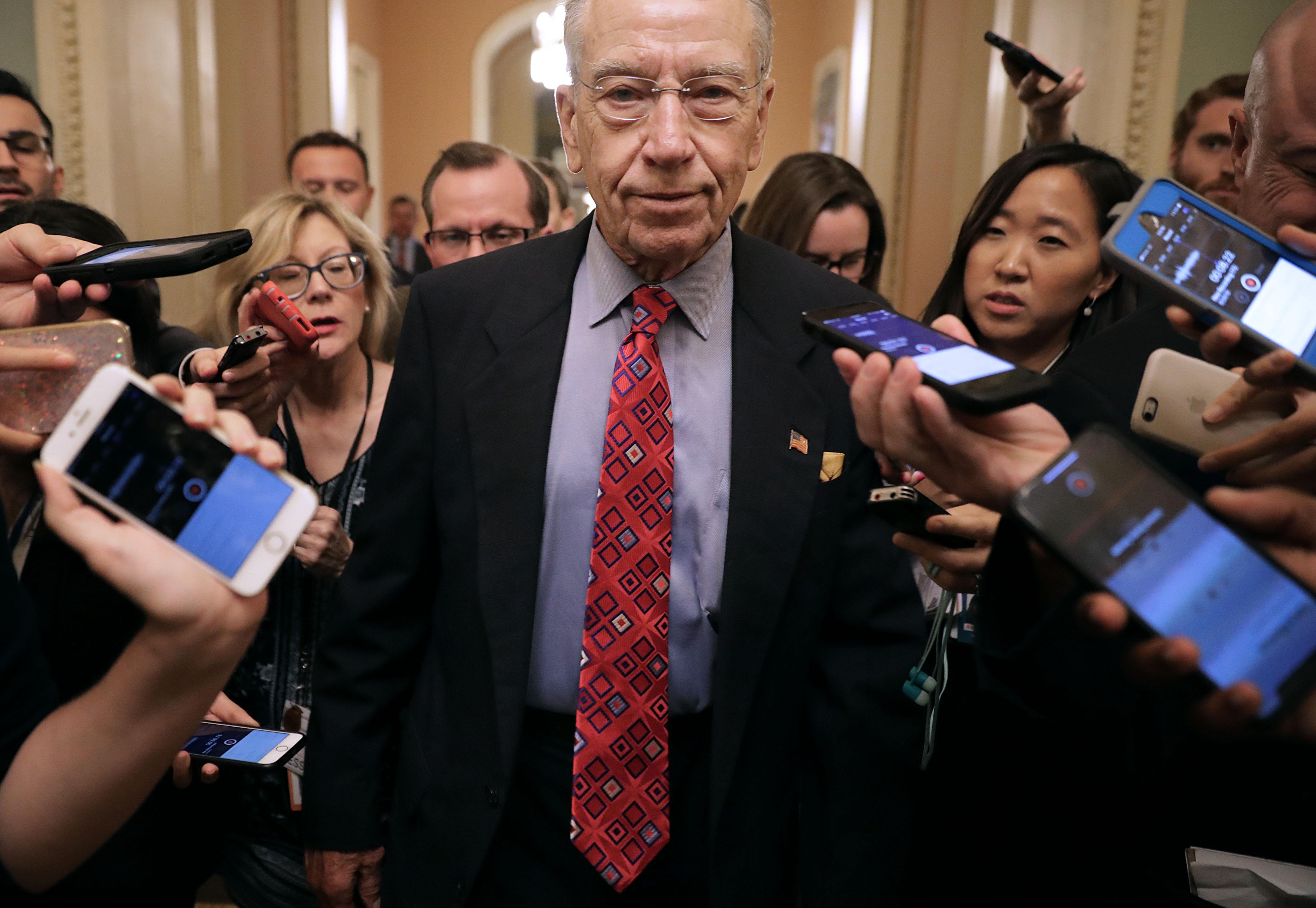 Senate Judiciary Committee Chairman Charles Grassley talks with reporters as he leaves a meeting in the Capitol.