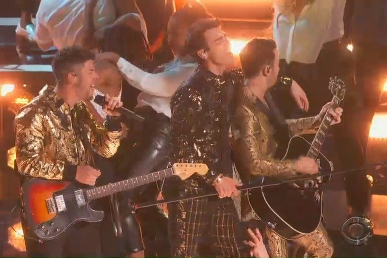 Nick, Joe, and Kevin Jonas perform onstage at the Grammys.