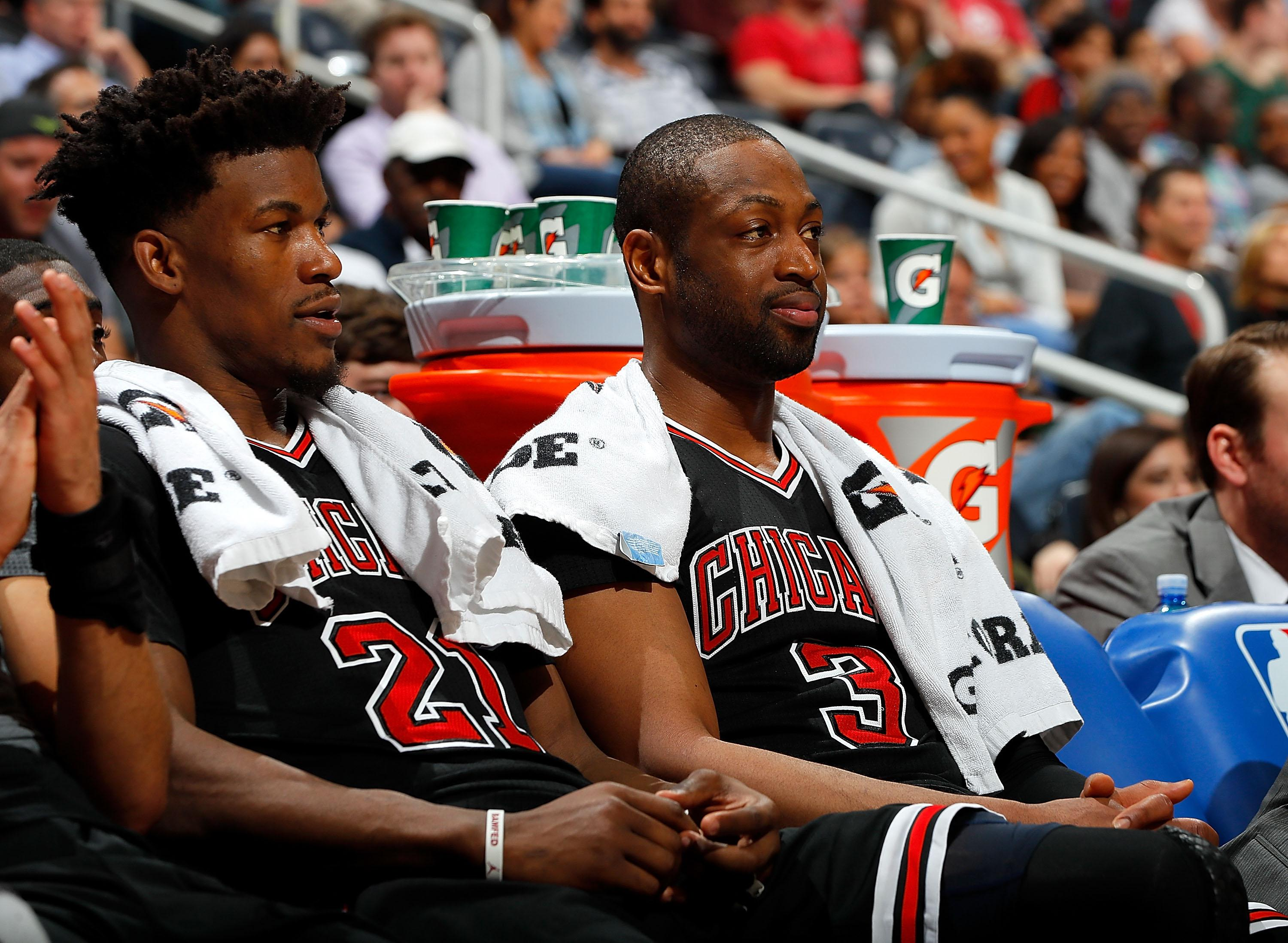 ATLANTA, GA - JANUARY 20:  Jimmy Butler #21 and Dwyane Wade #3 of the Chicago Bulls look on from the bench during the game against the Atlanta Hawks at Philips Arena on January 20, 2017 in Atlanta, Georgia.  NOTE TO USER User expressly acknowledges and agrees that, by downloading and or using this photograph, user is consenting to the terms and conditions of the Getty Images License Agreement.  (Photo by Kevin C. Cox/Getty Images)