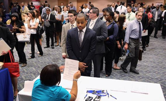 Job applicants line up to meet potential employers at a job fair on June 11, 2012 in New York City.
