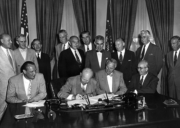 President Dwight D. Eisenhower signs a bill into law.