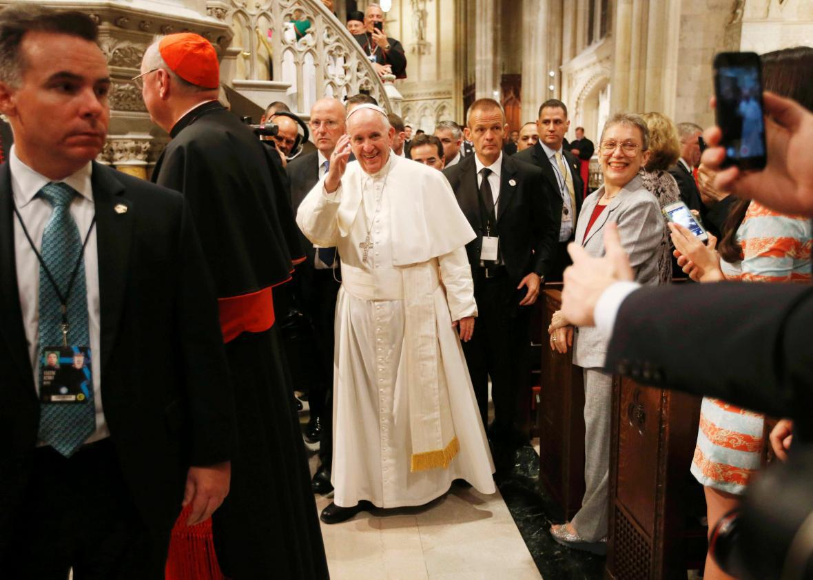 Pope Francis waves as he departs after presiding over evening prayers at St. Patrick's Cathedral in New York, September 24, 2015.
