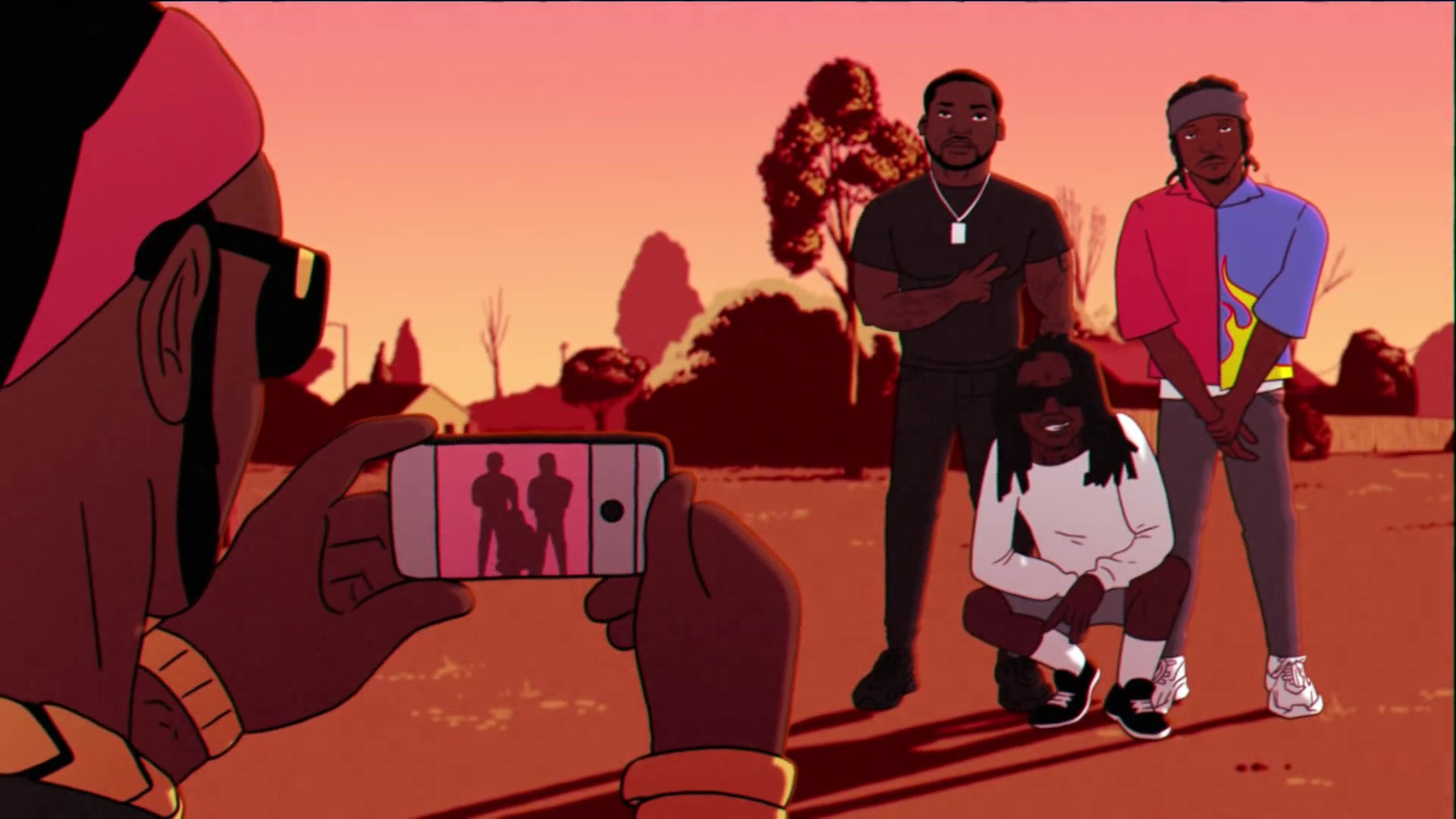 A man who appears to be 2 Chainz (he's seen only from the back) snaps a photo of Meek Mill (left), Pusha T (right, in his flames shirt), and Lil Wayne (bottom).