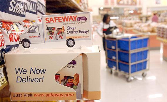 An advertisement for the new Safeway.com sits on a shelf at a Safeway store March 13, 2002, in San Francisco.