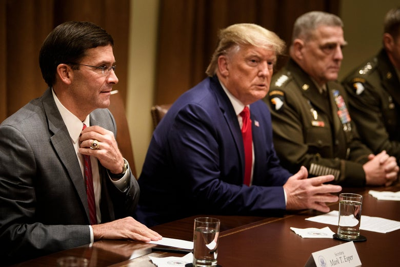 Esper, Trump, and Milley sitting in a row at a conference table