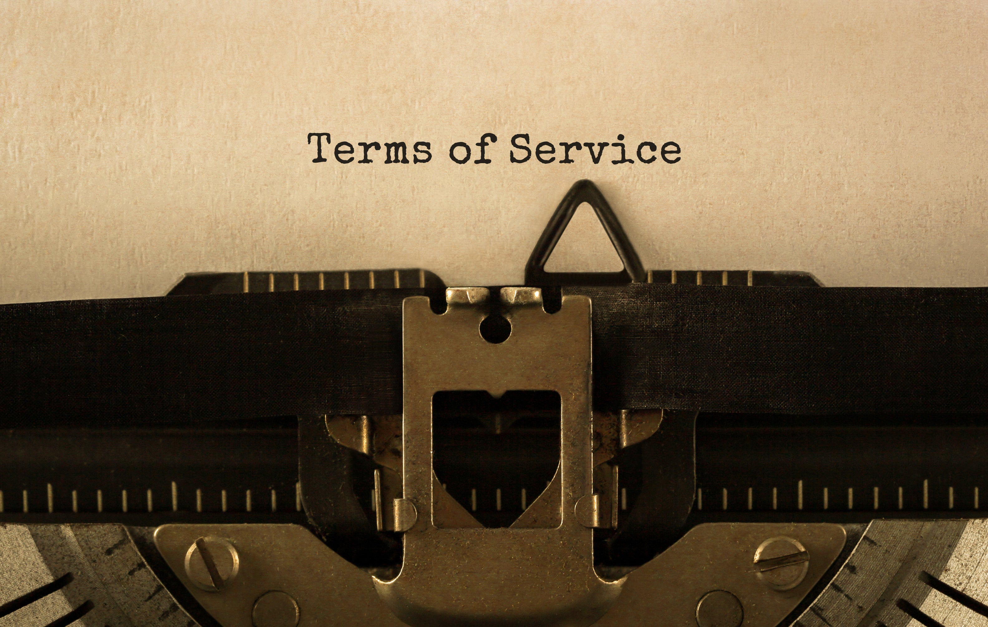 """""""Terms of service"""" appears on a typewriter."""
