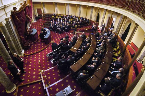 Members of the U.S. Senate sit down to a bipartisan caucus in the Old Senate Chamber on the first day of the 110th Congress at the U.S. Capitol in Washington January 4, 2007.