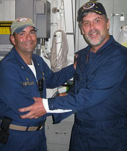 Maersk-Alabama Capt. Richard Phillips (right) stands alongside Cmdr. Frank Castellano. Click image to expand.