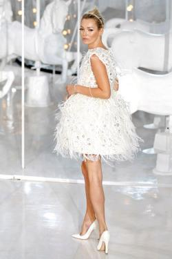 British supermodel Kate Moss presents a creation by U.S. designer Marc Jacobs, as part of his Spring/Summer 2012 women's ready-to-wear fashion collection for French fashion house Louis Vuitton, during Paris Fashion Week.