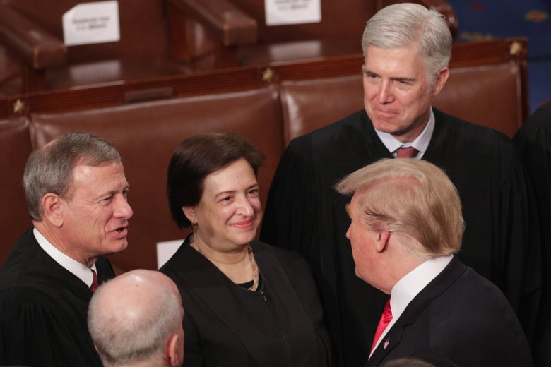 Supreme Court Justices John Roberts, Elena Kagan, and Neil Gorsuch greet President Donald Trump after the State of the Union address on Feb. 5 in Washington.