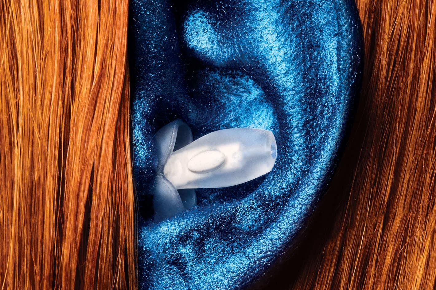 Closeup of a Happy Ears earplug in a woman's ear.