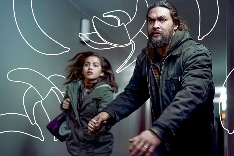 A hulking bearded Jason Momoa drags a much smaller Isabela Merced behind him