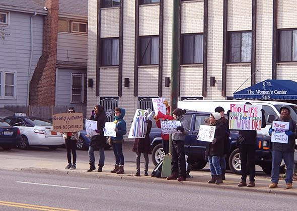 Members of Chicago feminist group FURIE protest crisis pregnancy