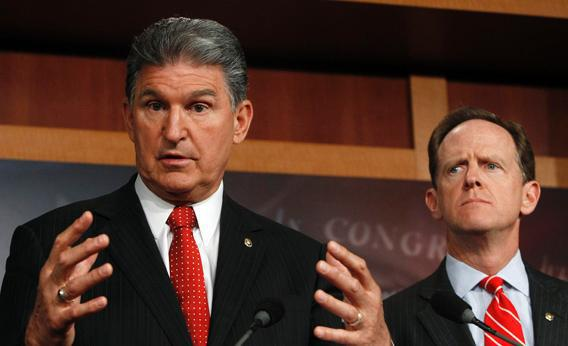 Sen. Joe Manchin, D-W.Va., and Sen. Pat Toomey, R-Pa., hold a news conference on background checks for firearms on Capitol Hill in Washington April 10, 2013.
