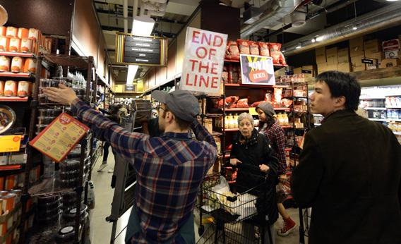 People try to get through the aisles at Whole Foods Market in midtown in New York on Sunday, as residents do last minute food shopping in preparation for Hurricane Sandy.