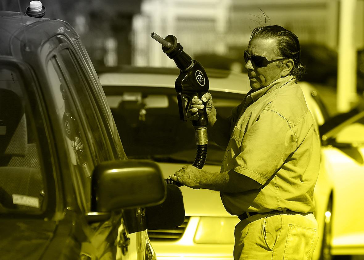 A customer prepares to pump gasoline.