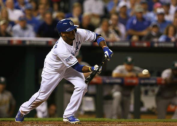 Alcides Escobar #2 of the Kansas City Royals hits a sacrifice bunt in the third inning against Oakland Athletics during the American League Wild Card game.