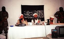 This undated file photo shows Saudi dissident Osama bin Laden (center), with two unidentified associates in an undisclosed place inside Afghanistan in 1998. Click image to expand.
