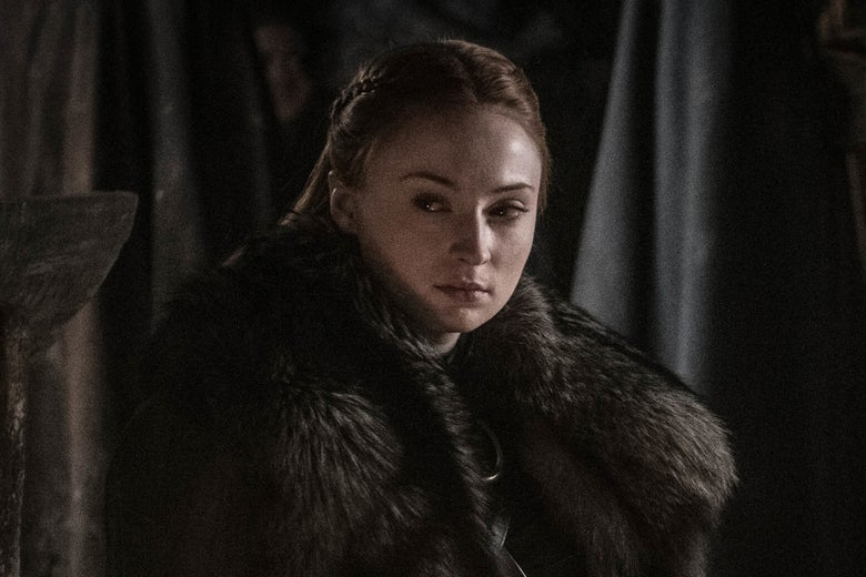 Sophie Turner in costume, glancing to one side.