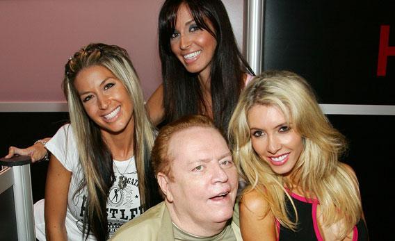 Hustler magazine publisher Larry Flynt poses with Hustler models (from left) Vanessa Graw, Tanya Schafer and Nikki Gray