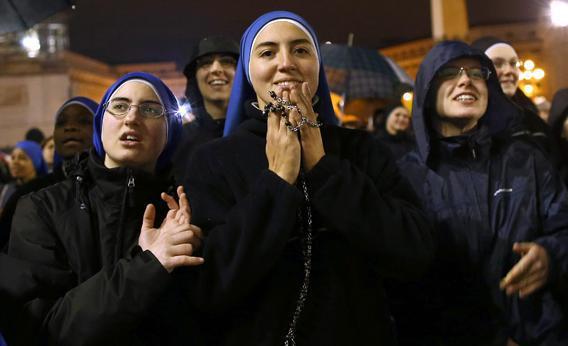 Nuns from the 'Instituto Serve del Signore, E Della Vergine Di Matara,' (Servants of the Lord and the Virgin of Matara,) react to the black smoke.