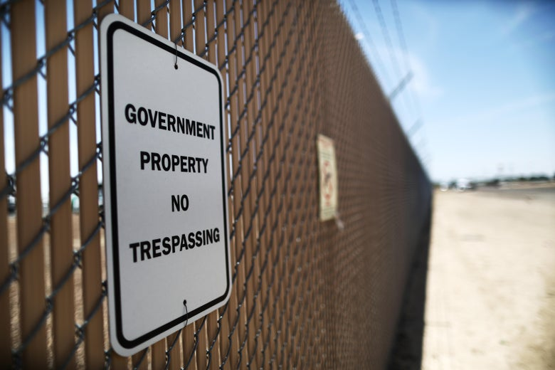 """A sign reading """"government property, no trespassing"""" is posted at the U.S. Border Patrol station on June 26, 2019 in Clint, Texas."""