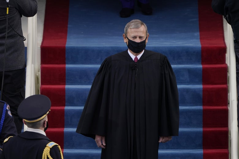 Roberts walking in a black mask and black robe.