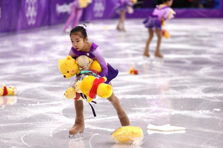 GANGNEUNG, SOUTH KOREA - FEBRUARY 16:  Skaters pick up gifts thrown to the ice for Yuzuru Hanyu of Japan during the Men's Single Skating Short Program at Gangneung Ice Arena on February 16, 2018 in Gangneung, South Korea.  (Photo by Maddie Meyer/Getty Images)