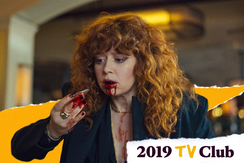 Natasha Lyonne holds and stares at a shard of glass she just pulled out of her mouth. Her hand and mouth are bloody.
