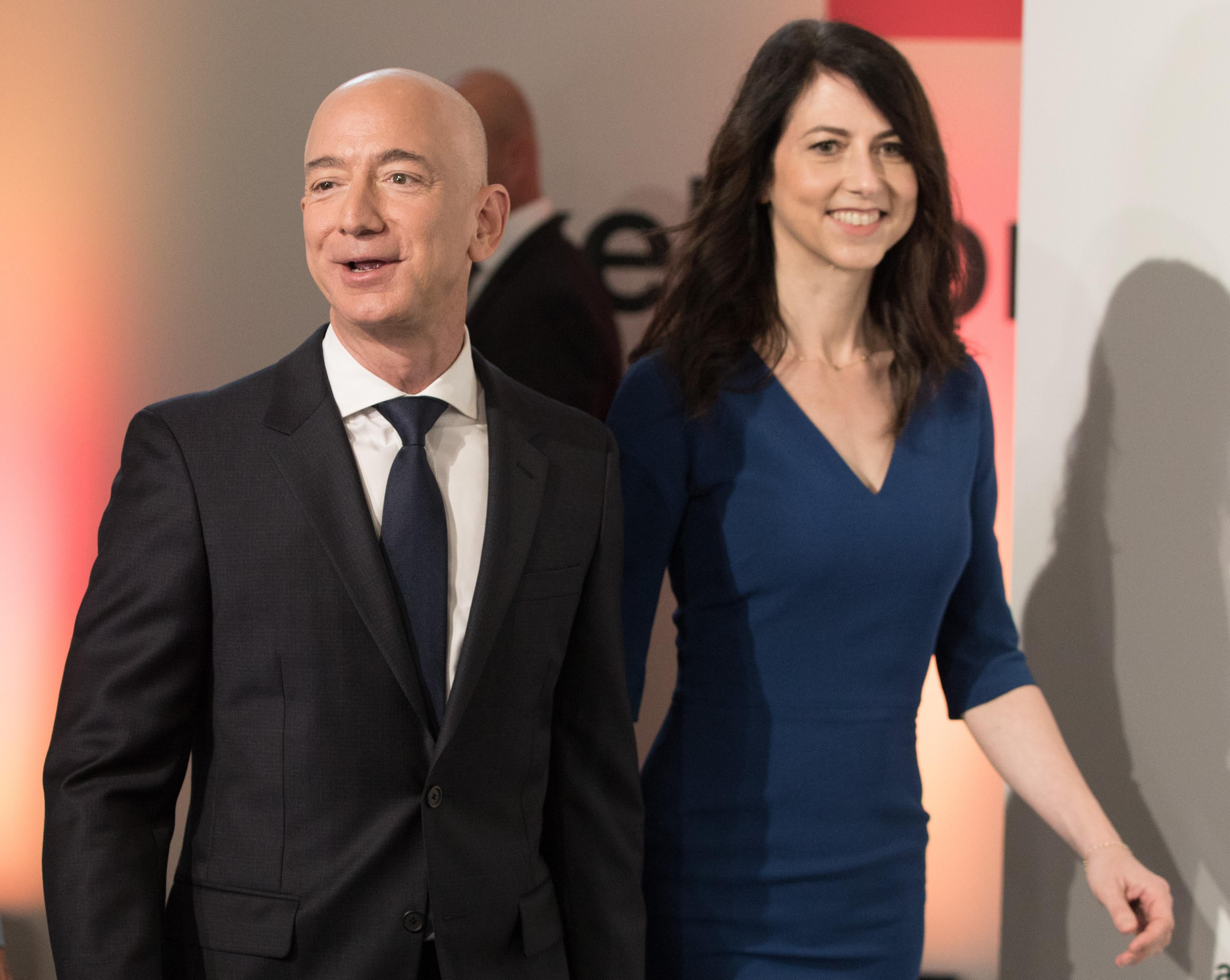 Amazon CEO Jeff Bezos and his wife MacKenzie Bezos arrive at an event.