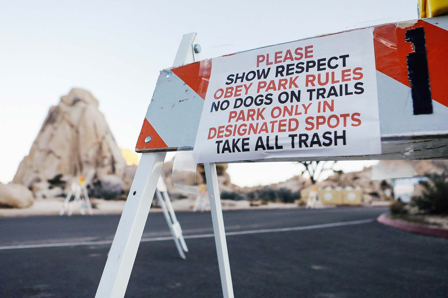 A sign placed by staff is posted on a temporary barricade at a closed campground at Joshua Tree National Park.