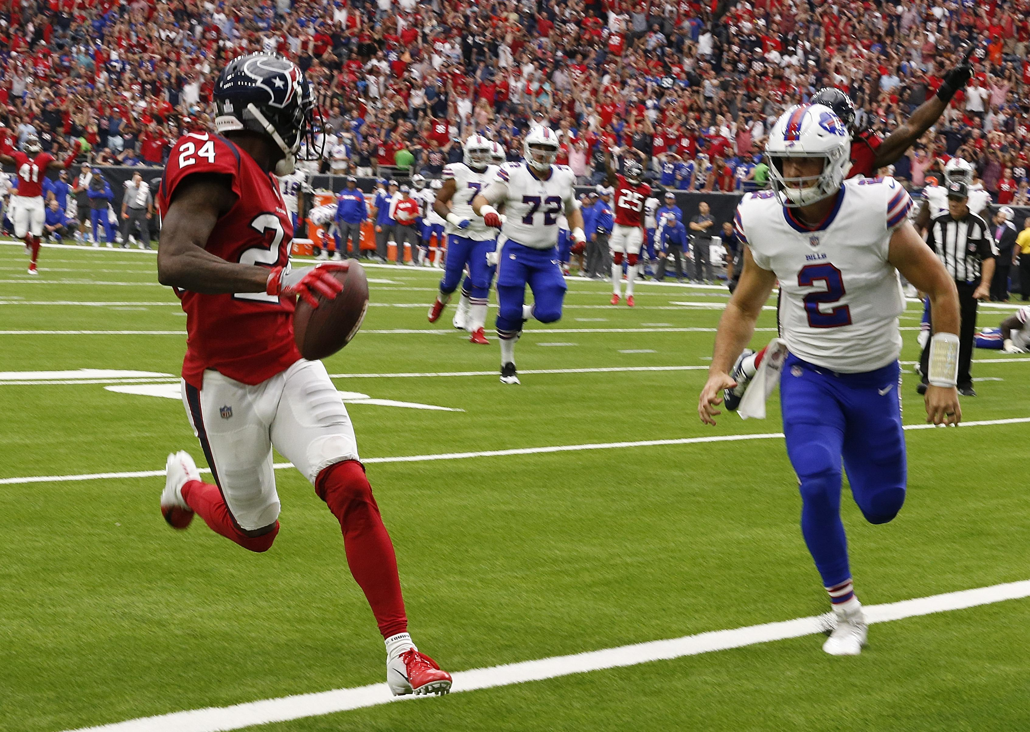 HOUSTON, TX - OCTOBER 14:  Johnathan Joseph #24 of the Houston Texans scores on an intereption as Nathan Peterman #2 of the Buffalo Bills is late on the coverage at NRG Stadium on October 14, 2018 in Houston, Texas.  (Photo by Bob Levey/Getty Images)