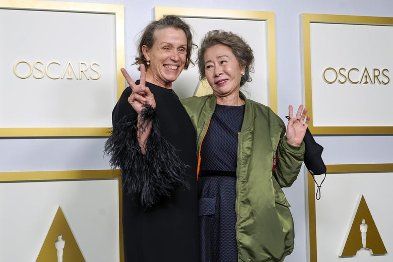 """LOS ANGELES, CALIFORNIA - APRIL 25: (L-R) Frances McDormand, winner of Best Actress in a Leading Role for """"Nomadland,"""" and Yuh-Jung Youn, winner of Best Actress in a Supporting Role for """"Minari,"""" pose in the press room at the Oscars on Sunday, April 25, 2021, at Union Station in Los Angeles. (Photo by Chris Pizzello-Pool/Getty Images)"""