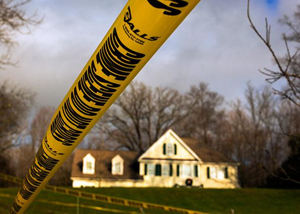 Crime scene tape remains outside Nancy Lanza's Sandy Hook Village home in Newtown, Connecticut December 18, 2012.