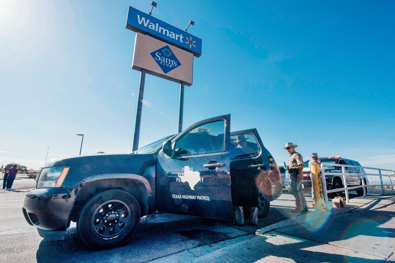 A Texas State Trooper vehicle and some officers stand outside in a parking lot with a Walmart sign visible behind them.
