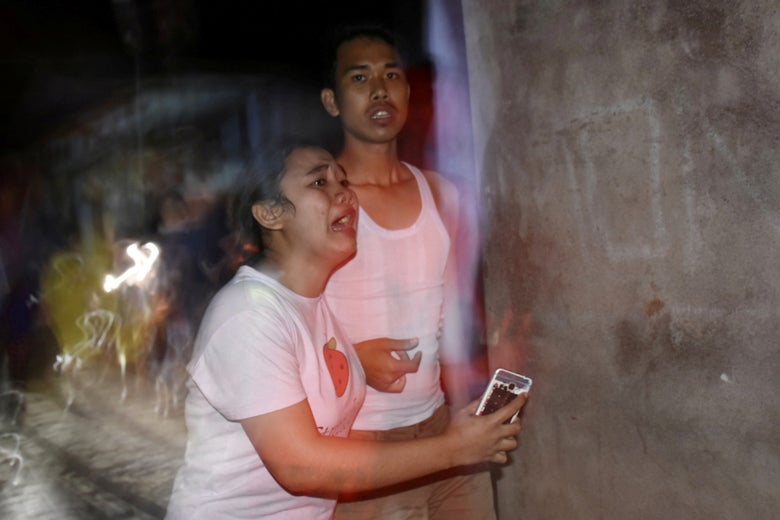 People react following an earthquake in Ampenan district, Mataram, Lombok, Indonesia on August 5, 2018.